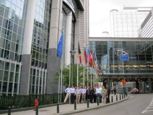 The Emory EvMBA group outside the de facto headquarters of the European Union. (The blue flag with yellow stars is that of the E.U.)