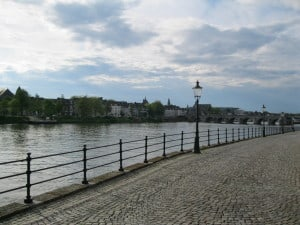 Cobblestone streets by the River Maas (which actually starts in France and also runs through Belgium).