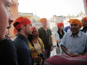 Day 1 - 3:30pm: After getting off the rickshaws, we toured the Red Fort and Jama Masjid, India's largest mosque. We had to wear orange head covers to go inside the mosque