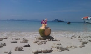 Post China trip, relaxing on the beach in Thailand, on Phi Phi Beach. Great, fresh Pina Coladas!
