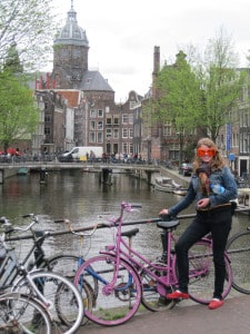Christine posing with some Ajax (Dutch soccer team) orange sunglasses and her pink bike in Amsterdam. Eat your heart out, Lady Gaga!
