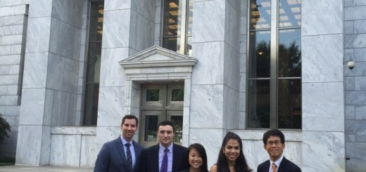 Team One in front of the Atlanta Federal Reserve
