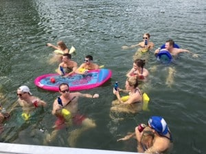 Students from the 2016, 2017 and 2018 Evening MBA program cooling off in the waters of Lake Allatoona during Boat Day 2015.